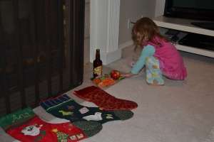 After bath the most important task of the evening.  Putting Santa's beer, apple and  nut bar, and some carrots out for the reindeer beside the stockings.
