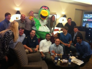 Yep, that's Papi at the back being strangled by the mascot.  Apparently it's all part of the job.