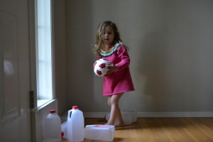 We play knock em down with empty milk cartons and a mini soccer ball