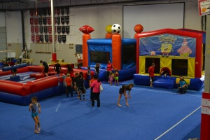 My gym celebrated its 35th birthday today and it hosted the coolest party.  The gym doesn't normally have bounce houses in it!