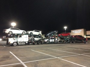 The truck took up 10 car park spaces!  It was exciting to watch our car come off.