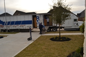 The big truck delivered all our toys and other essentials 20 days after our late night arrival to Houston.  No wonder we're all tired!