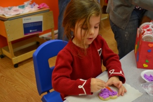 Today we had a Valentines day party at school.  All the parents were invited (and Mum was impressed how many turned up) and we enjoyed making heart cookies with pink and purple icing!