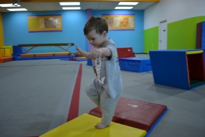 He was a natural already doing forward rolls, handstands on the wall, swinging on the bar and walking on the balance beam.  But his favourite thing to do was big jumps!