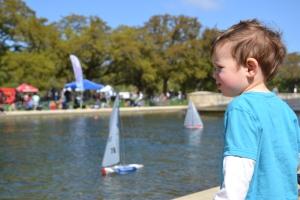 Watch racing model boats.