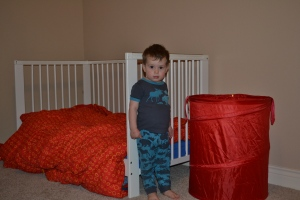A red laundry hamper for Rafa's room.