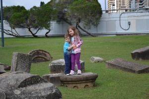 Play time on pieces of an old building facade at the Opera House entrance to the Botanic Gardens.