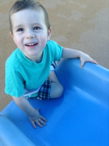 Playing outside on the slide.