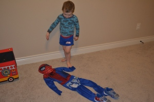 After bath we laid out our costumes all ready for the morning.  Rafa thought it was hilarious that Papi put his undies outside his pants.  Spiderman doesn't wear his undies on the outside of his pants!!