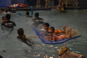 Then we all kick to propel the mat for a lap around the pool.