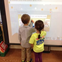 Playing 'Color Me Hungry' on the promethean board with my friend Murray