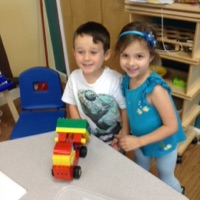 We built a dump truck with our box of bricks.