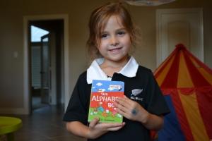 Ana with an alphabet book?!