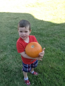 The teacher's made a big pumpkin patch and we got to pick another one to bring home.